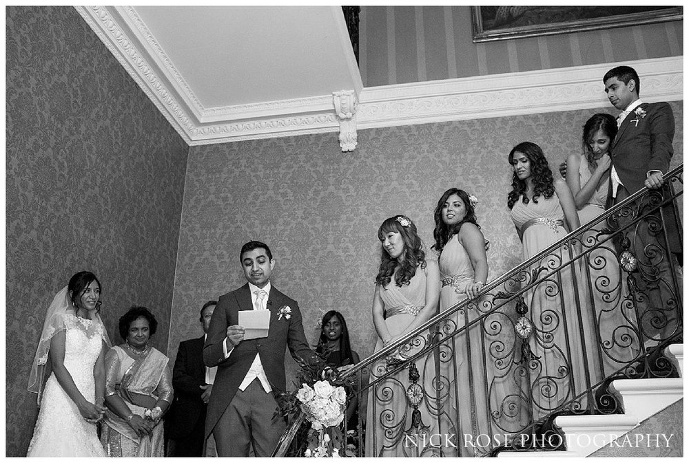 Speeches on the main staircase for a Hedsor House wedding reception in Buckinghamshire