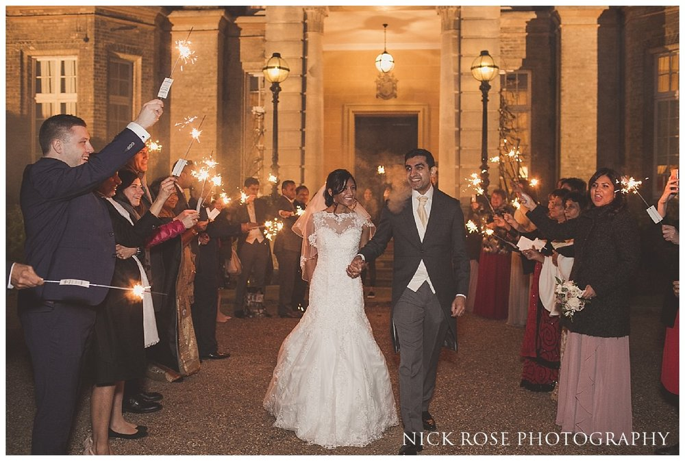 Bride and groom sparkler exit after a Hedsor House wedding reception in Buckinghamshire