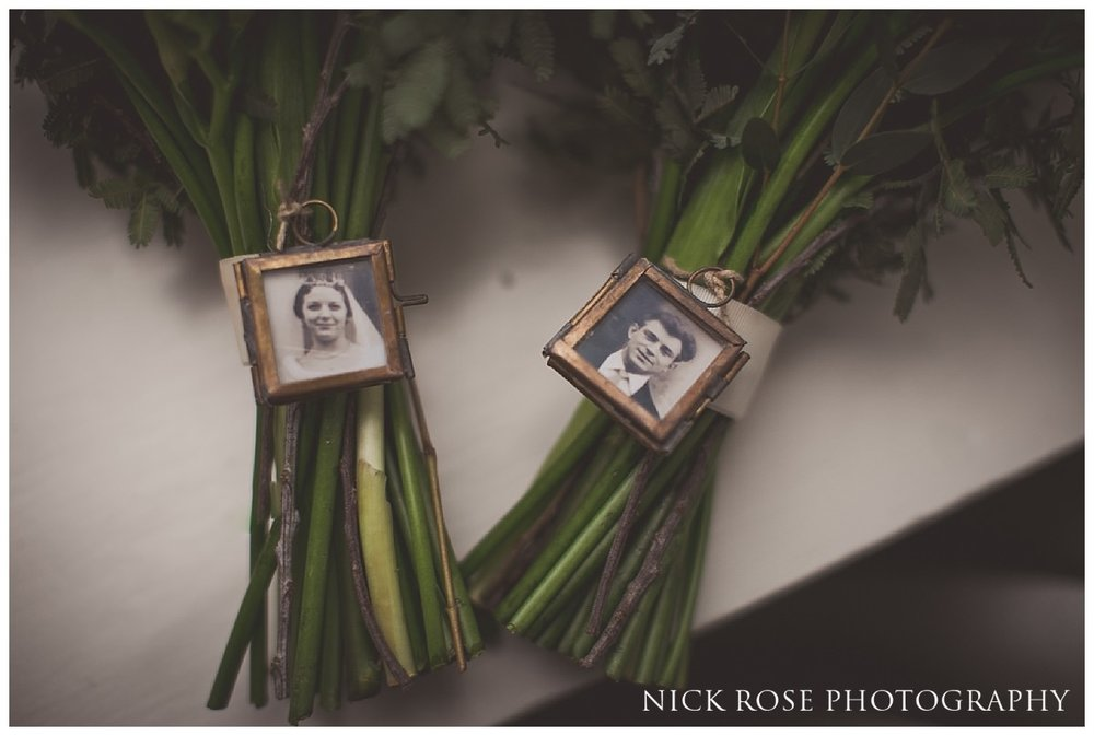 Bridal bouquet with grandparents photographs at Threadneedles Hotel in London