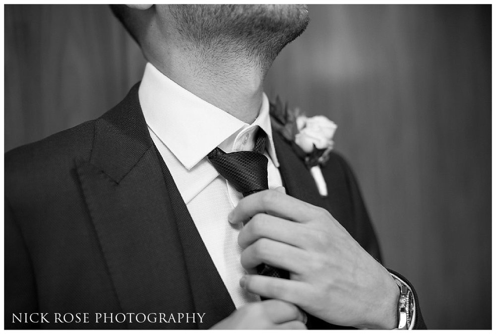 Groom getting ready at Threadneedles Hotel in London