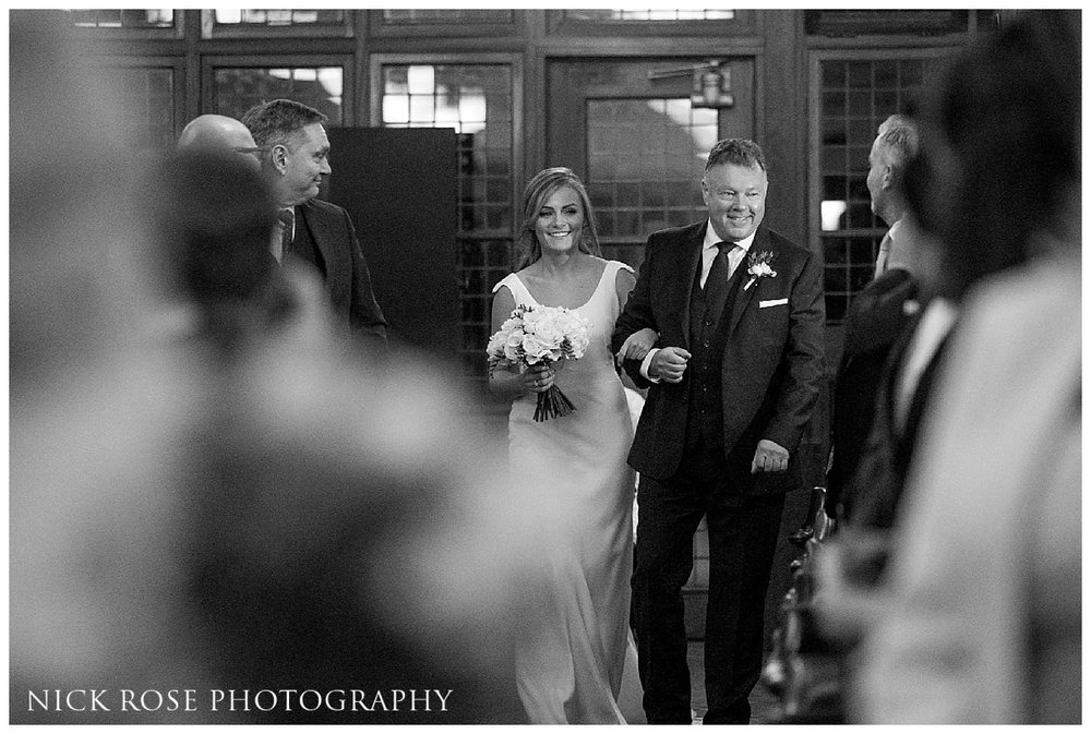Bride walking down the isle at a Hawksmoor Guildhall wedding ceremony in London