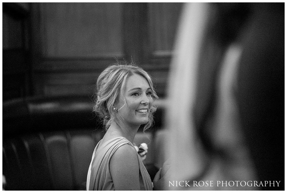 Bridesmaid watching ceremony during a Hawksmoor Guildhall wedding ceremony in London