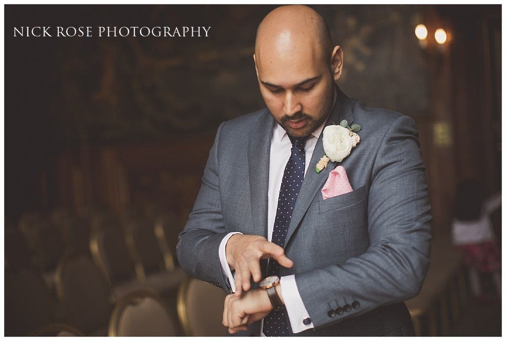 Wedding groom getting ready for a Moor Park Mansion Wedding in Rickmansworth Hertfordshire
