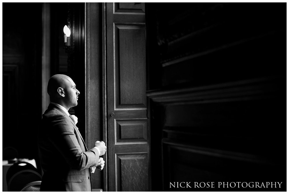 Groom standing by the window before a civil wedding ceremony at Moor Park Rickmansworth