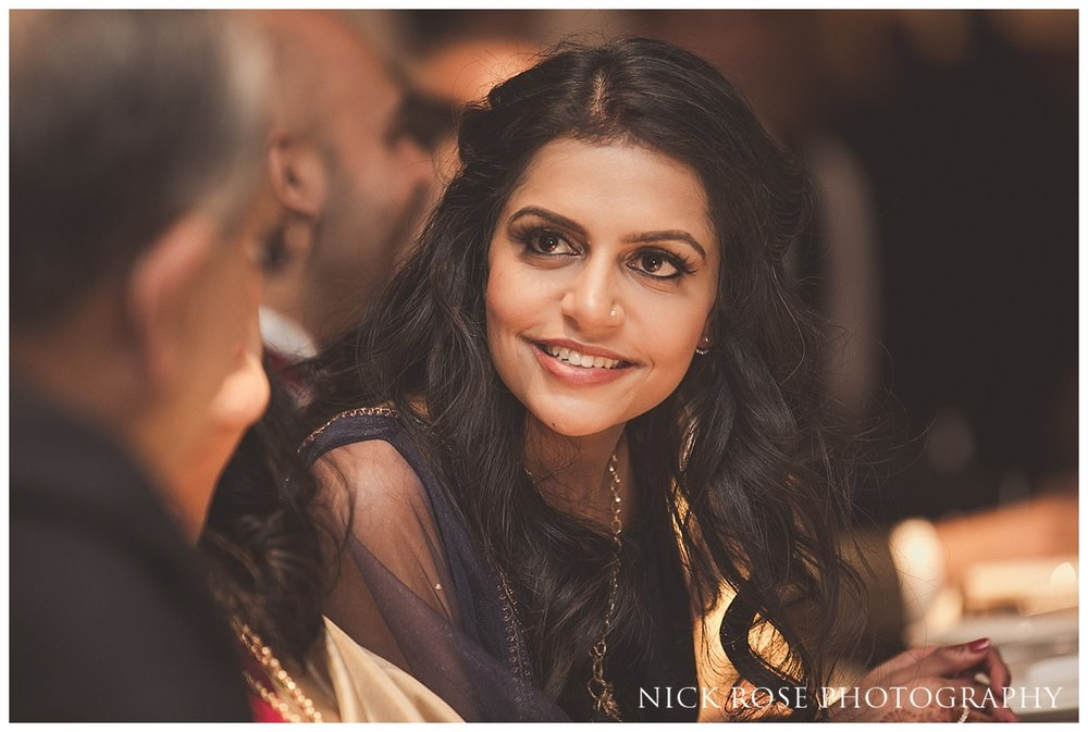 Bride smiling at Hindu wedding reception at The Grove in Chandler's Cross in Watford