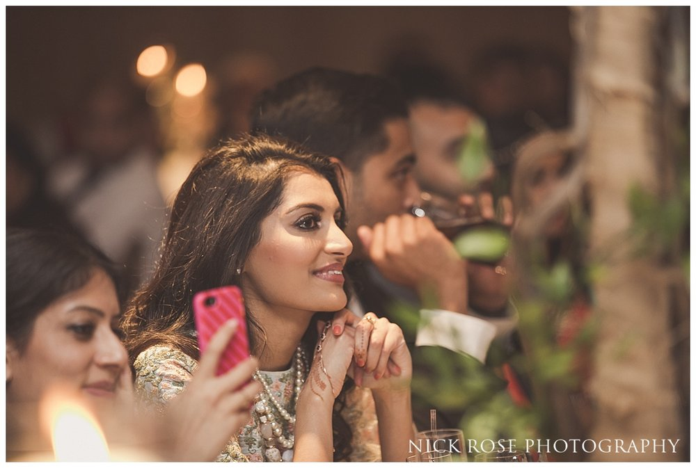 Guest smiling during the wedding speeches at The Grove in Watford