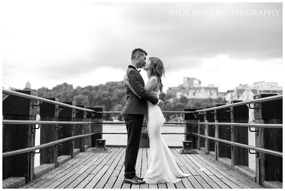 Engagement photography portrait on a jetty at London's Southbank along the River Thames