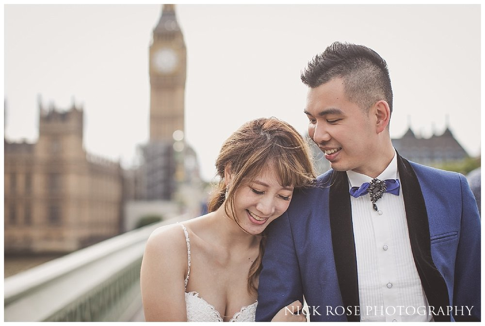 Couple walking over Westminster Bridge during a pre wedding photography shoot in London