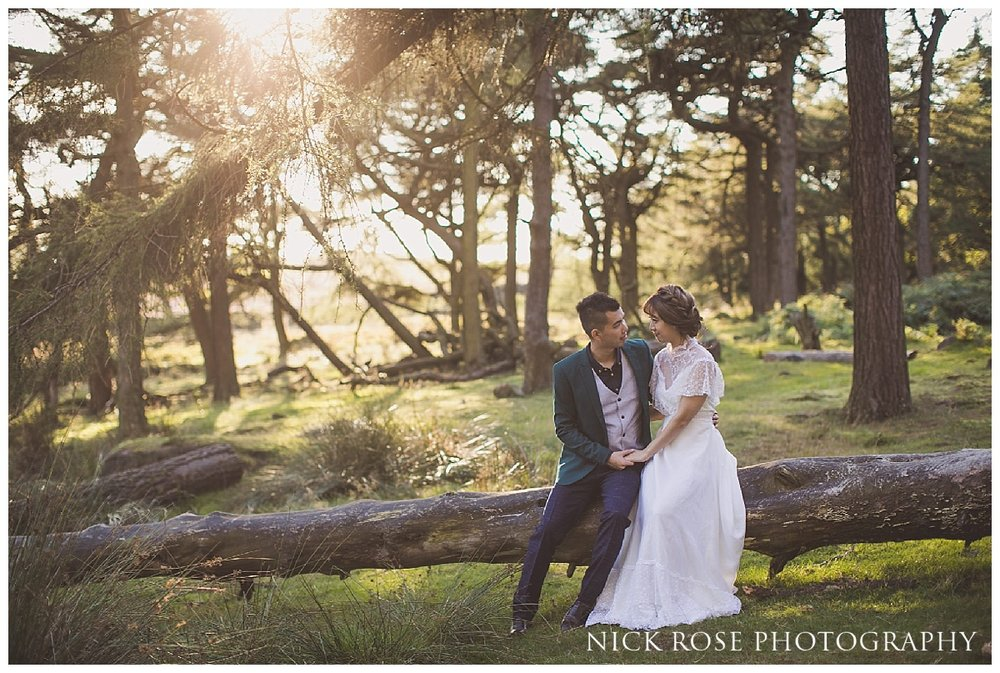 Pre wedding photography couple sitting on a fallen tree at sunset at the Roaches in the Peak District