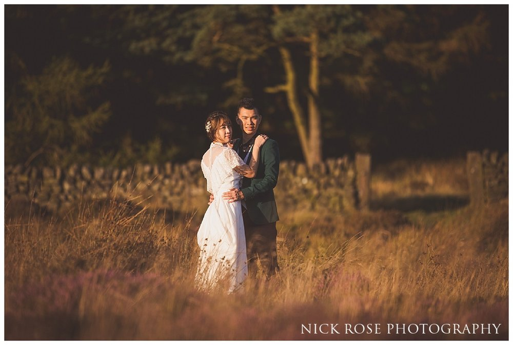 Couple from Hong Kong embracing during a sunset pre wedding photography shoot in the Peak District