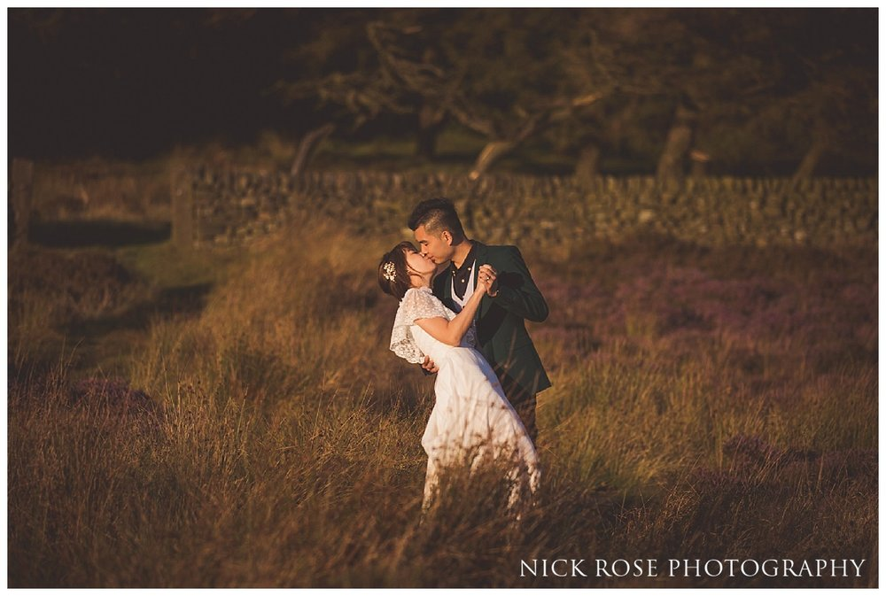 Couple from Hong Kong dancing during a sunset pre wedding photography shoot in the Peak District