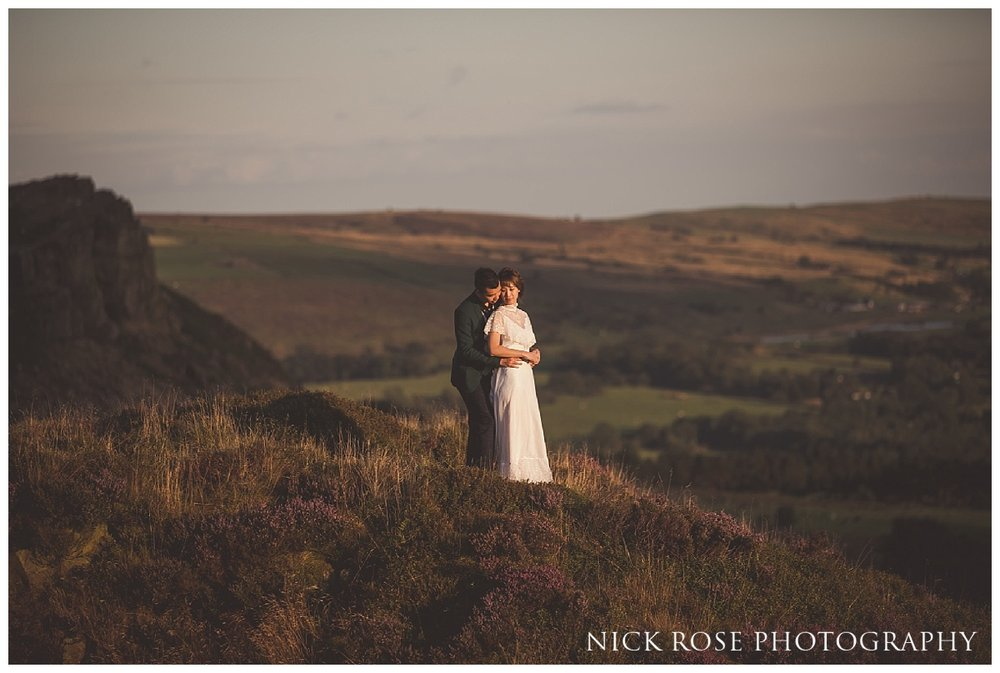 Groom with his arms around bride during a sunset pre wedding engagement photography shoot in the Peak District