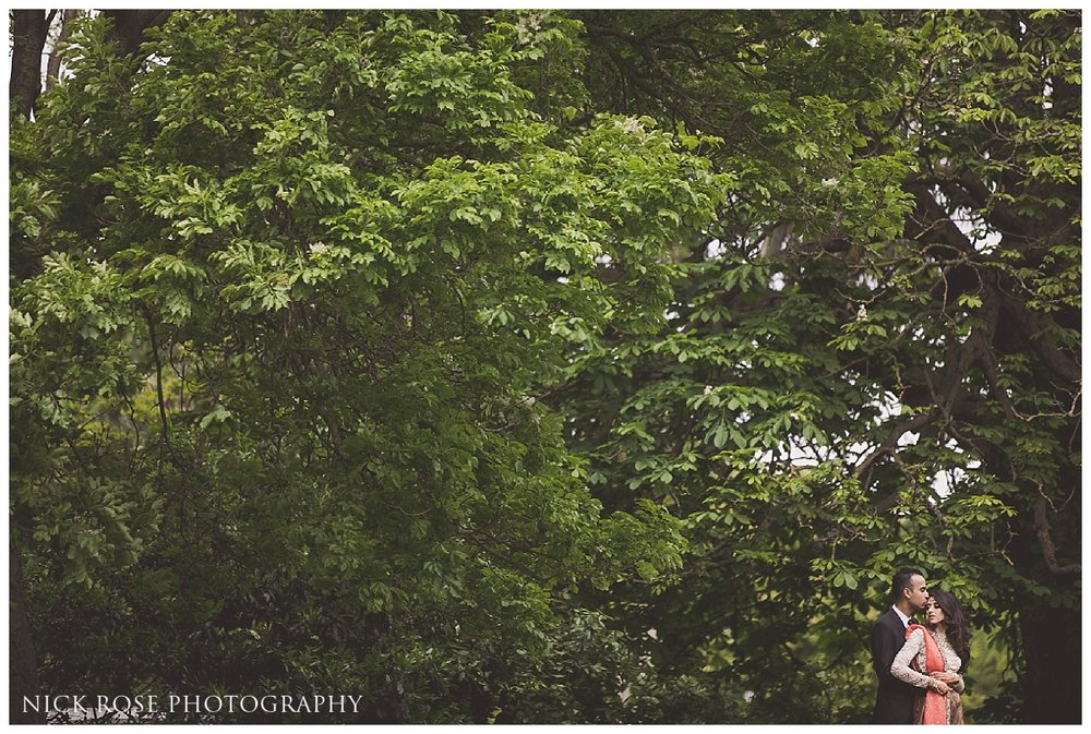 Pakistani bride and groom portrait in front of green trees in Hyde Park London
