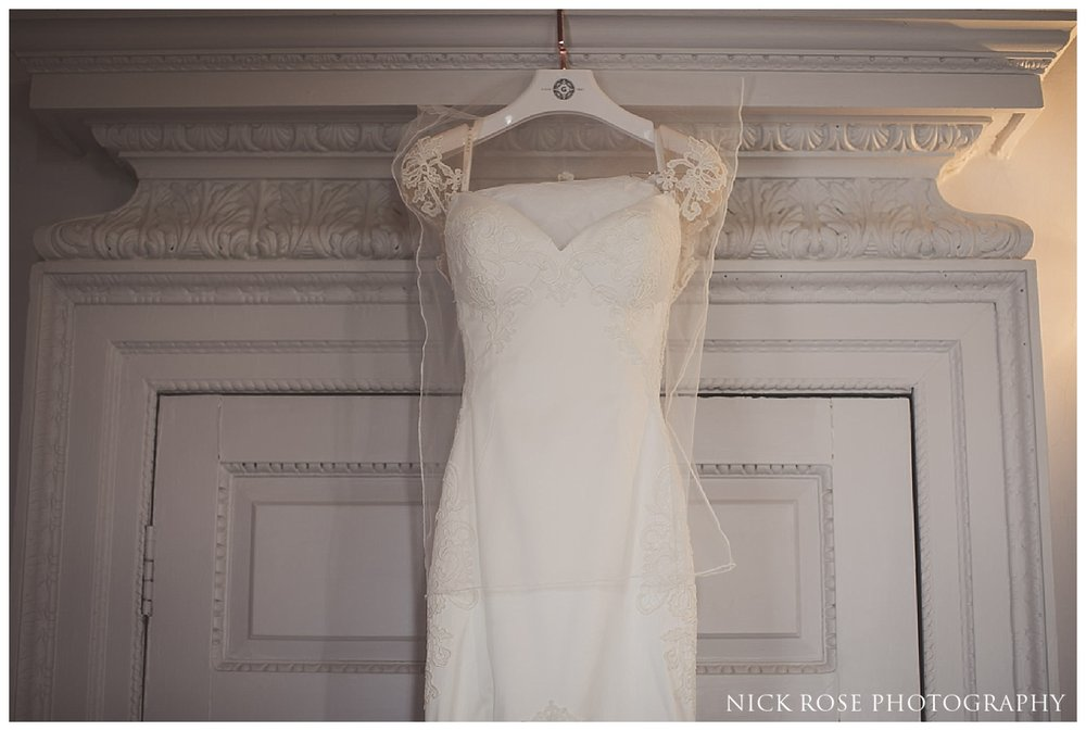 Wedding dress hanging up before a Buxted Park hotel wedding in East Sussex