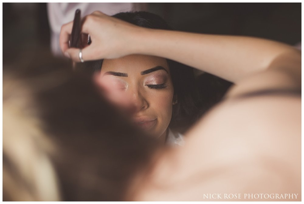 Bride getting ready for a Buxted Park hotel wedding in East Sussex