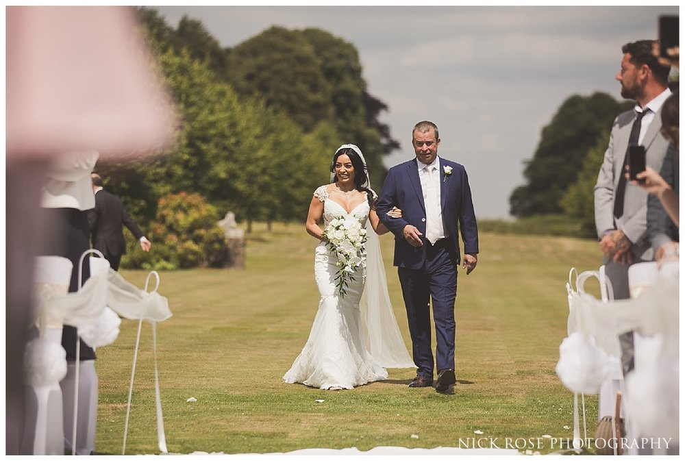 Outdoor wedding ceremony at Buxted Park in East Sussex
