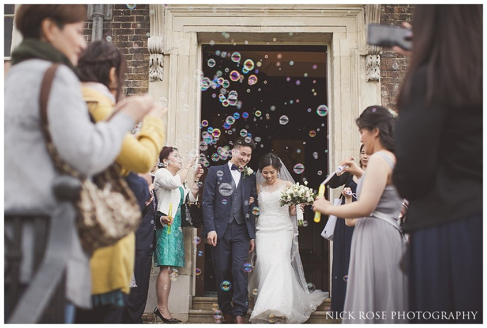 Bride and groom bubble confetti photograph at Hampton Court Palace
