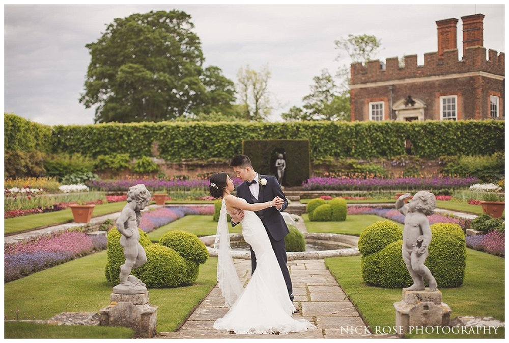 Bride and groom wedding photography portrait in the gardens at Hampton Court Palace