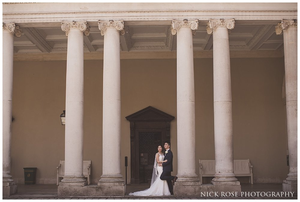 Bride and groom wedding photography portrait in the courtyard at Hampton Court Palace