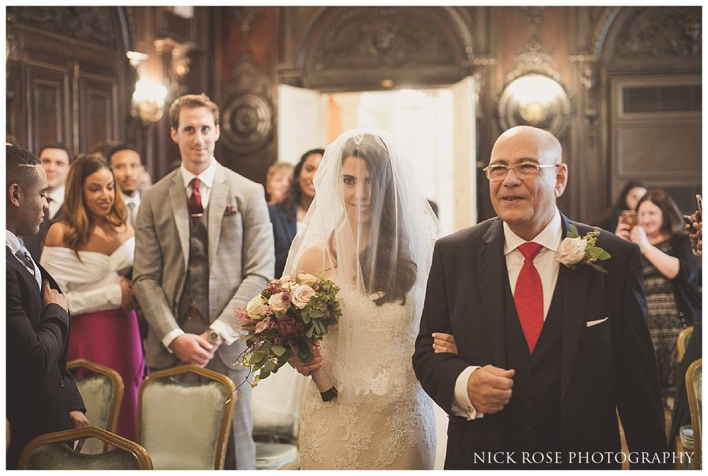 father walking daughter down the Isle for a Mayfair Wedding at Dartmouth House in London