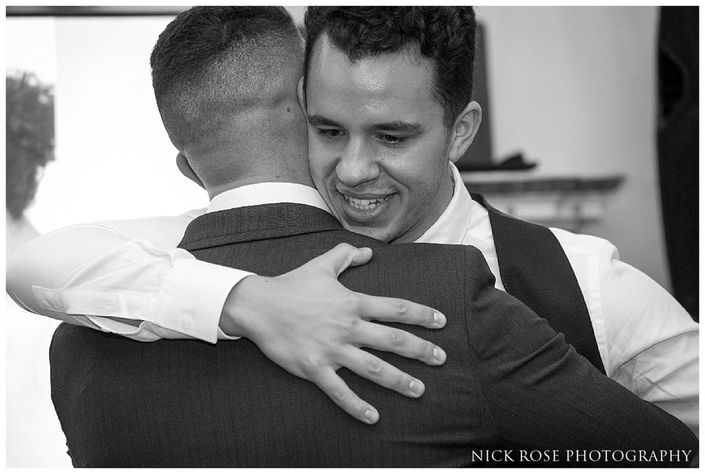 Groom and best man during a wedding reception at Dartmouth House