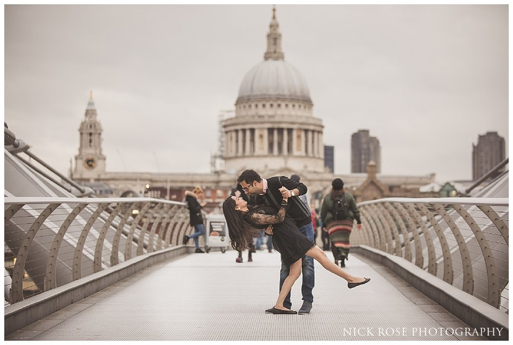 Pre wedding photography shoot on Millennium Bridge London in front of St Pauls Cathedral