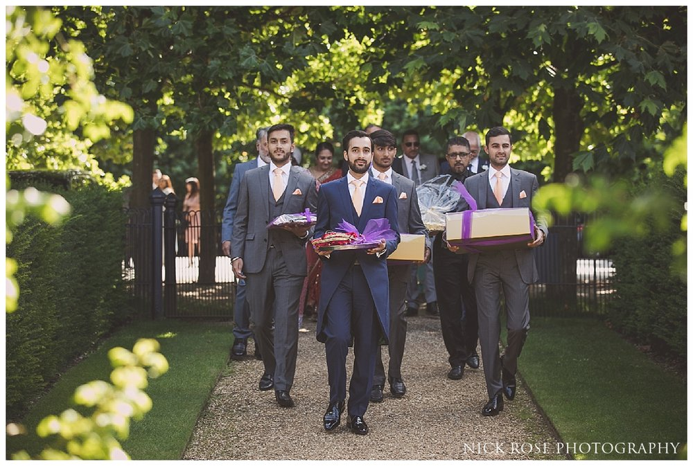Groom and groomsmen arriving for an outdoor wedding reception at The Dairy in Waddesdon Manor Buckinghamshire