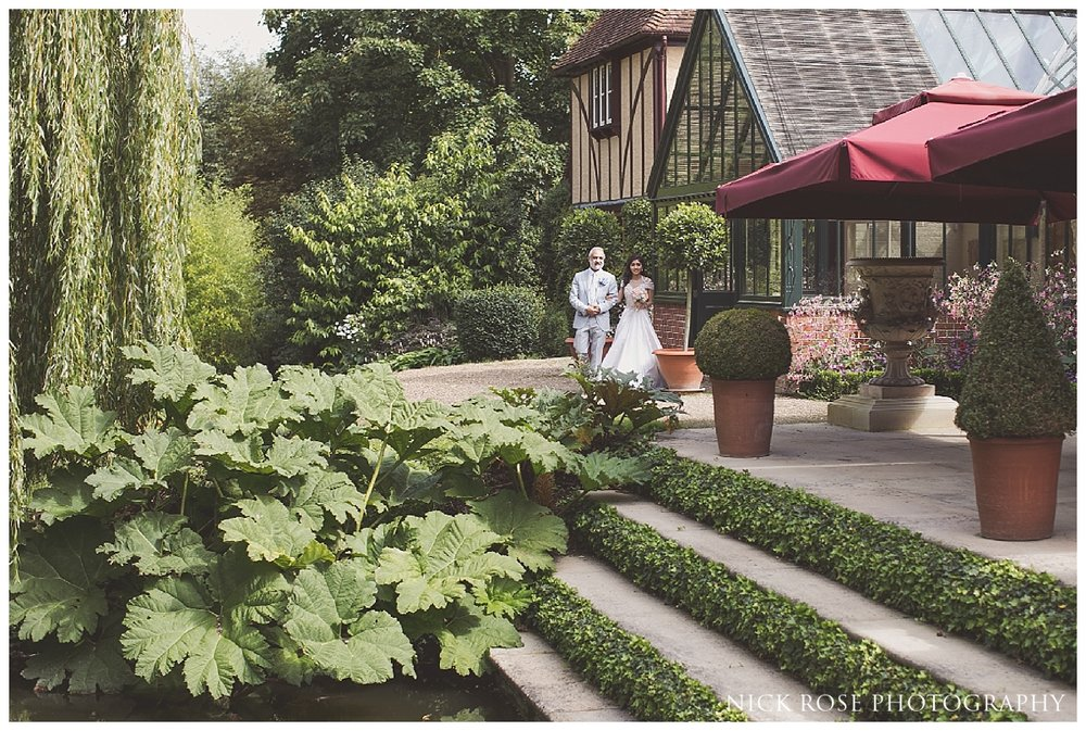 Bride entrance for an outdoor wedding reception at The Dairy in Waddesdon Manor Buckinghamshire