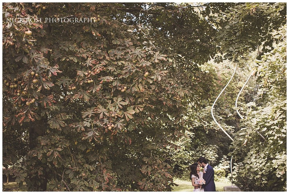 Summer wedding photography in the gardens at Waddesdon Manor in Buckinghamshire