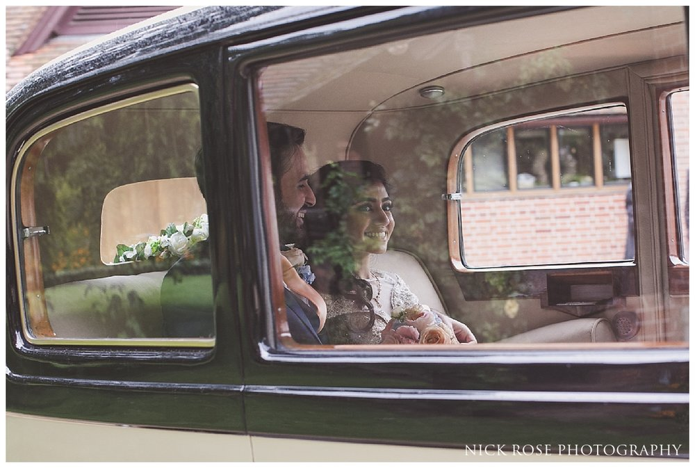 Bride and groom vintage car wedding exit from Waddesdon Manor in Buckinghamshire
