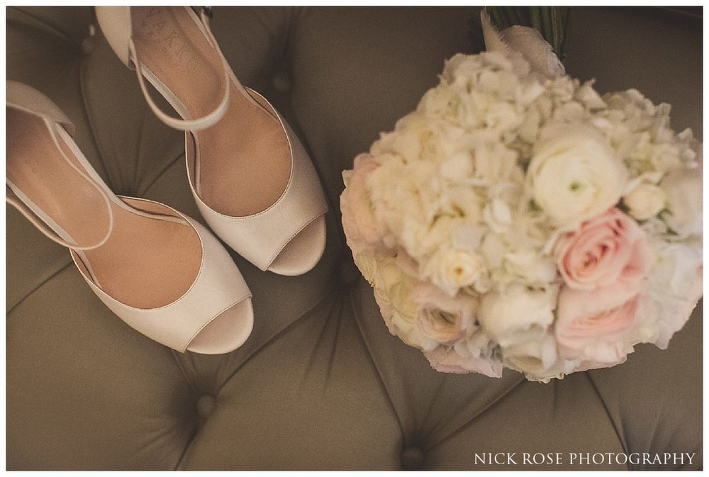 Brides shoes and bouquet for a London wedding at The Savoy Hotel