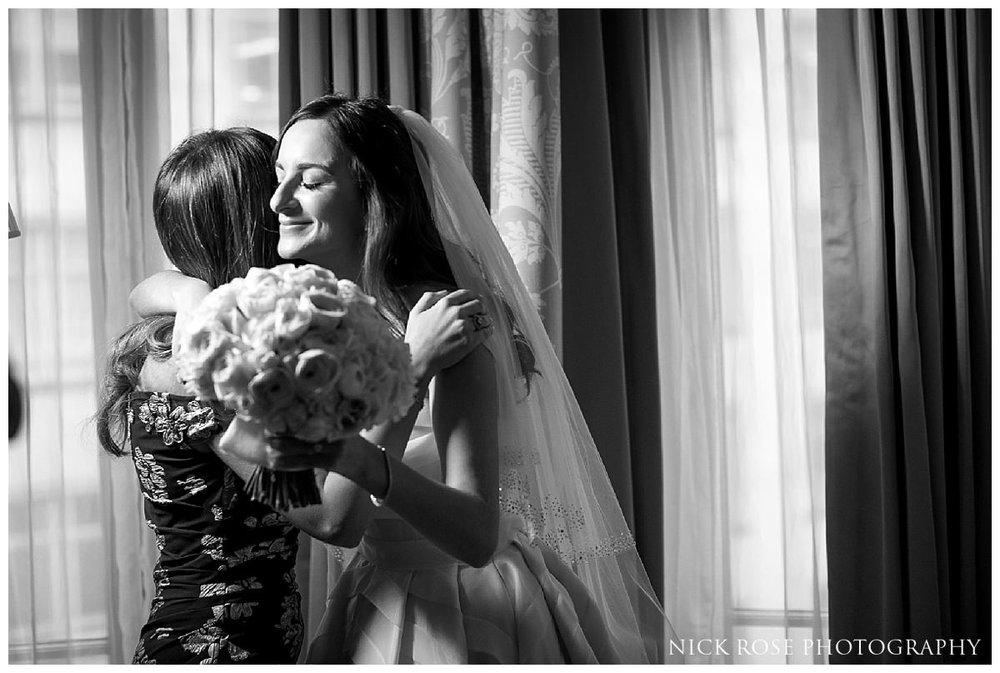Sister hugging bride before her Savoy London wedding