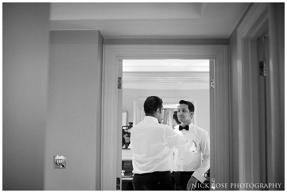 Groom and ushers getting ready for a Savoy London wedding in the UK