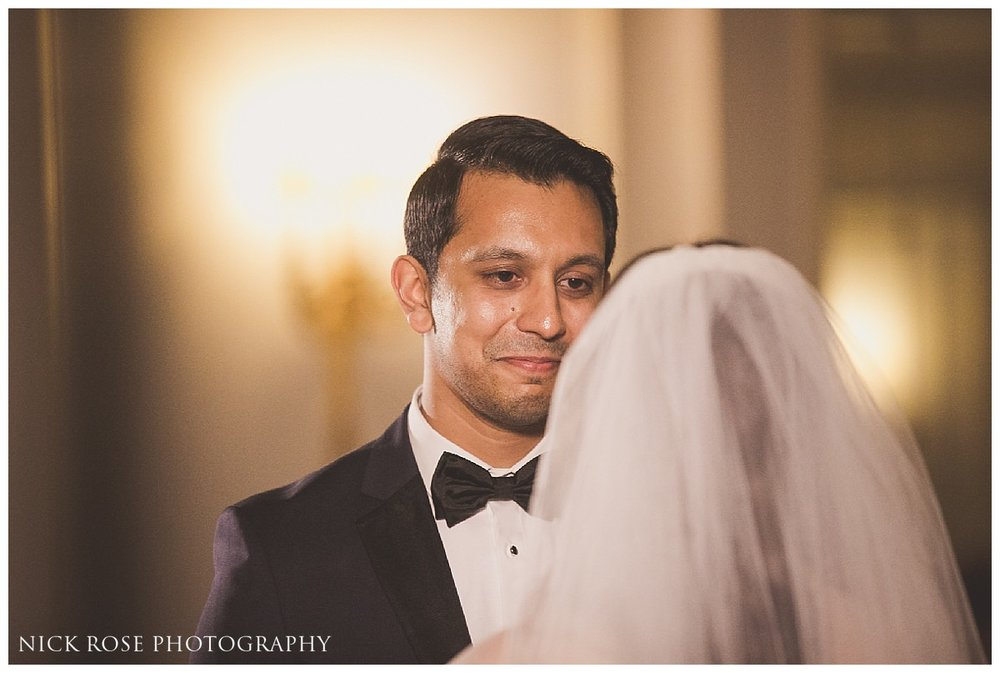 Groom looking at bride during a Savoy London wedding ceremony