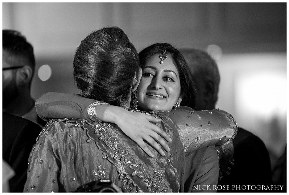 Guests hugging after a Savoy Hotel wedding in London