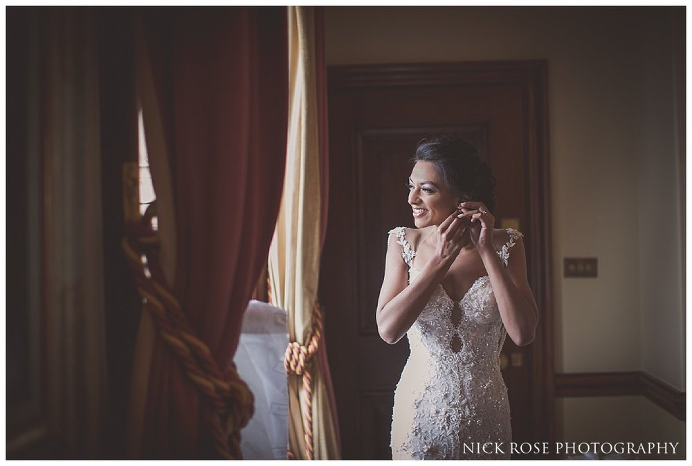 Bride getting ready for her Indian civil wedding at Stoke Park Hotel in Buckinghamshire