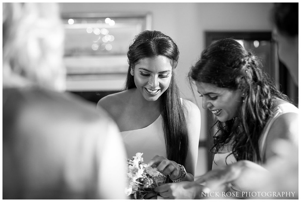 Bridesmaids getting ready for her Indian civil wedding ceremony at Stoke Park in Buckinghamshire