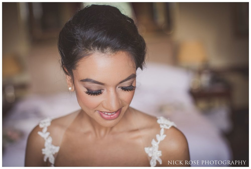 Bride getting ready for her Indian civil wedding ceremony at Stoke Park in Buckinghamshire
