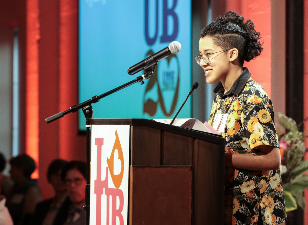 Azura Tyabji '14, performing her poem  for female revolution, for girls
