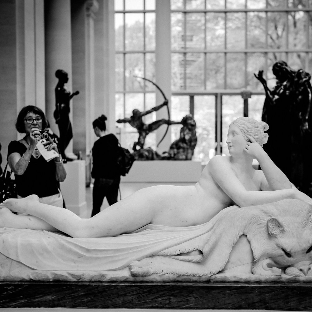 black and white photo of woman taking photo of nude sculpture at the MET People+Art fine art photography project Monica Michelle.jpg