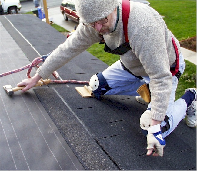 Roofer on knees setting three tab copy.jpg