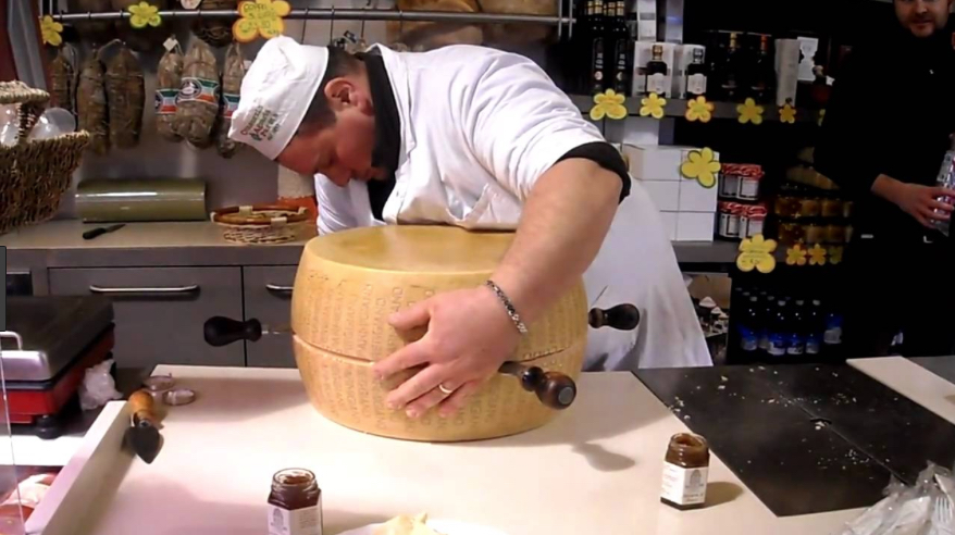 Cutting a Parmesan cheese in half