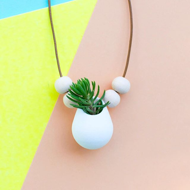 Getting ready for the holidays and making some variations of our bestselling planters! What do you think of this planter with some added wooden beads? #plantlady #plantladyisthenewcatlady #succulents #crazyplantlady #gardening #naturejewelry #leaf_ladies #succulents #statementjewelry #jungalowstyle #flauntyourleaves