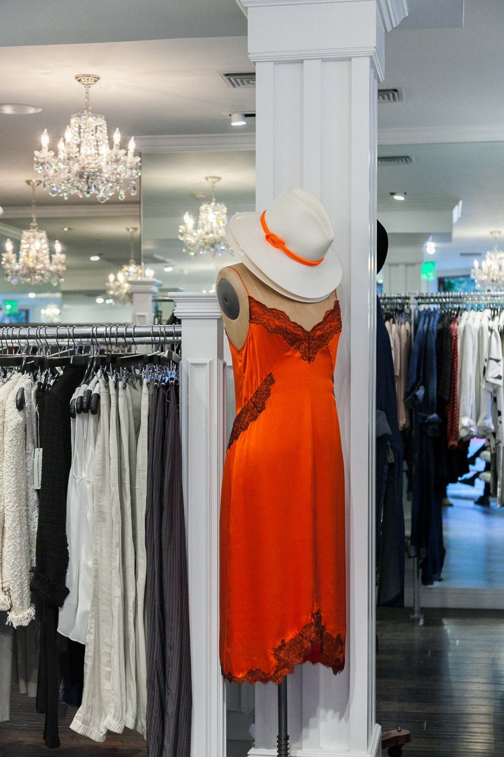An orange lingerie dress with hat at GBG, a stylish Carmel, CA boutique.