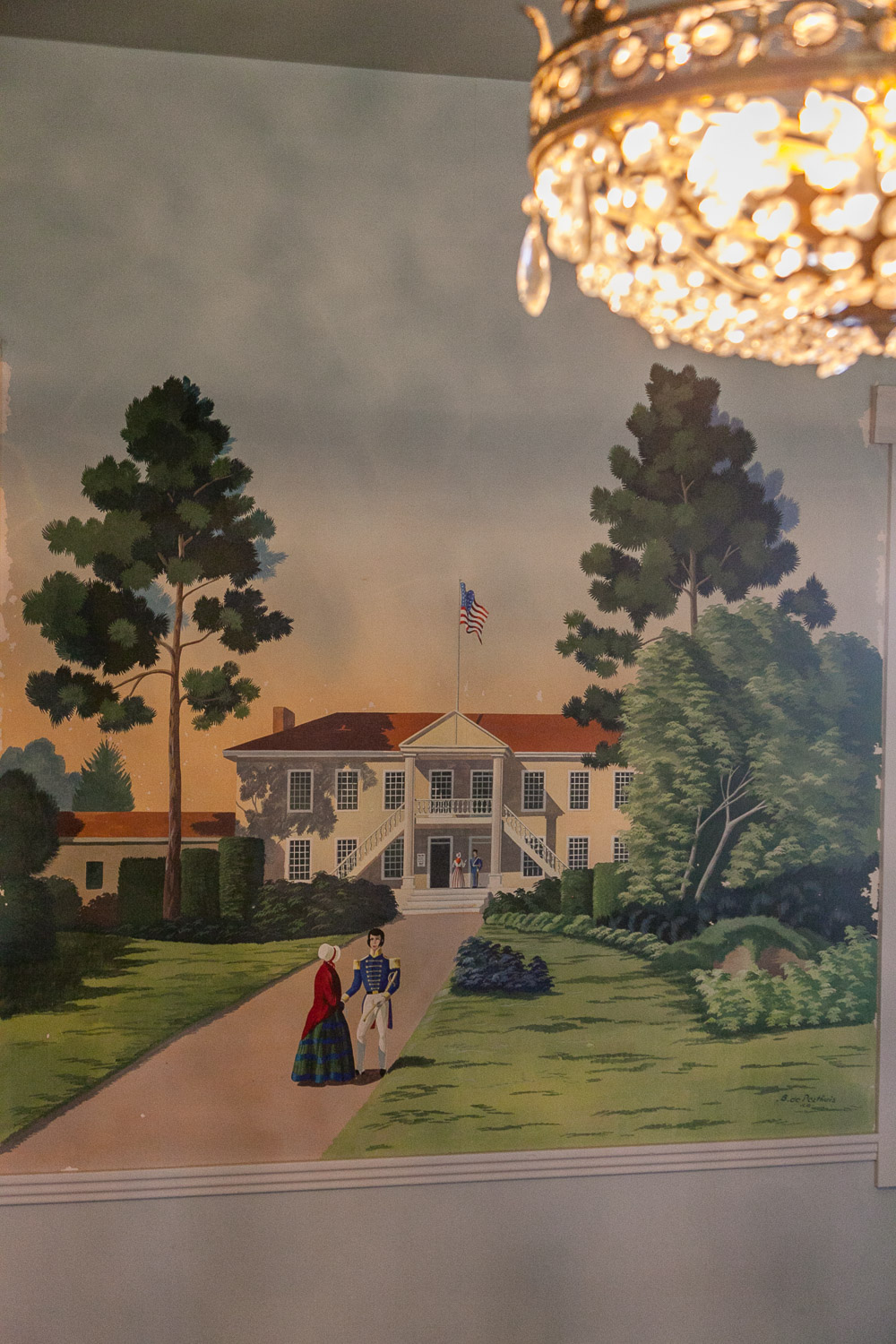 A detail of the charming murals and old chandelier inside the La Mirada location.