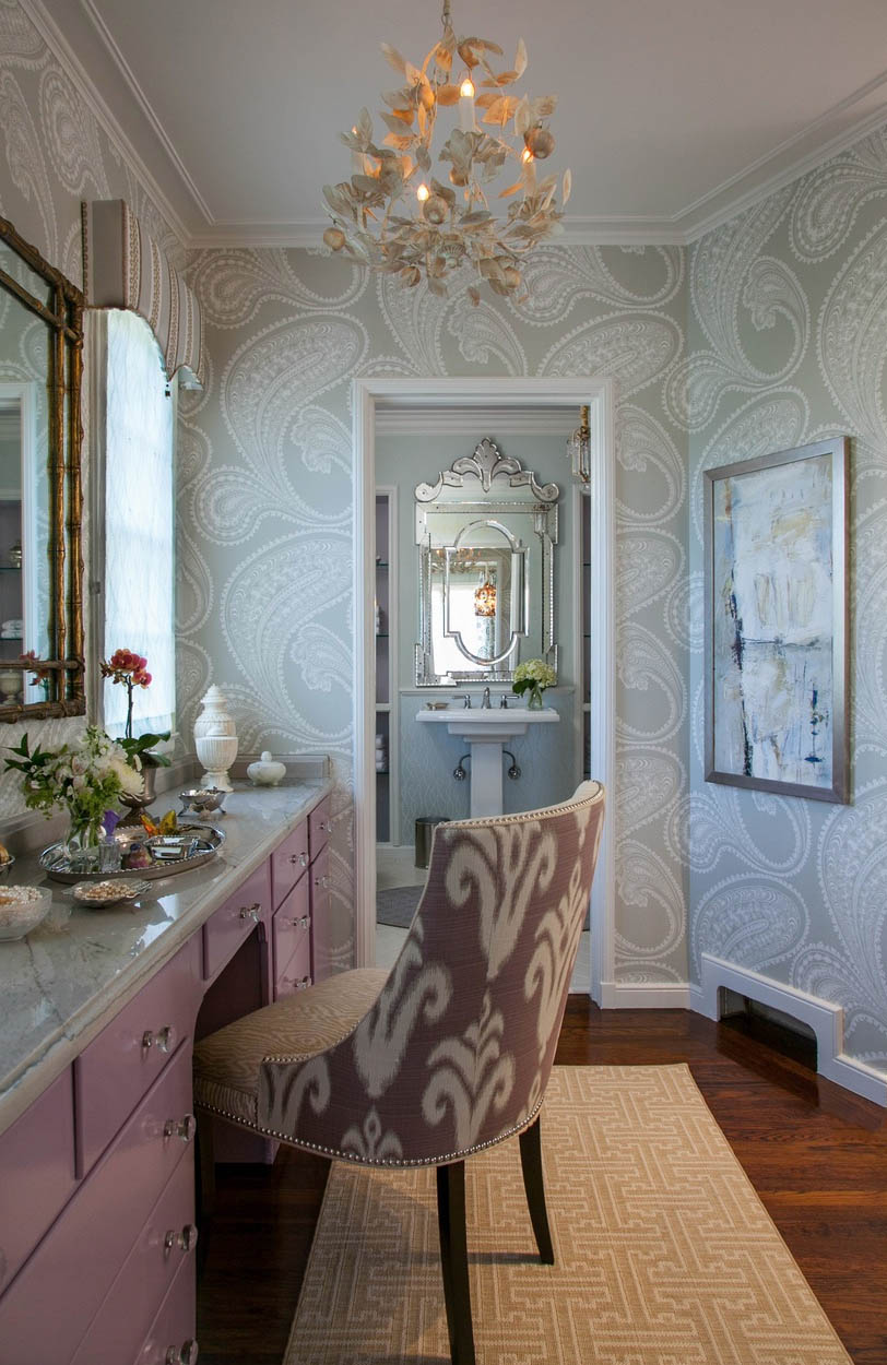 Our showcase guest bathroom utilizing exotic wallpaper adds drama to a small space.