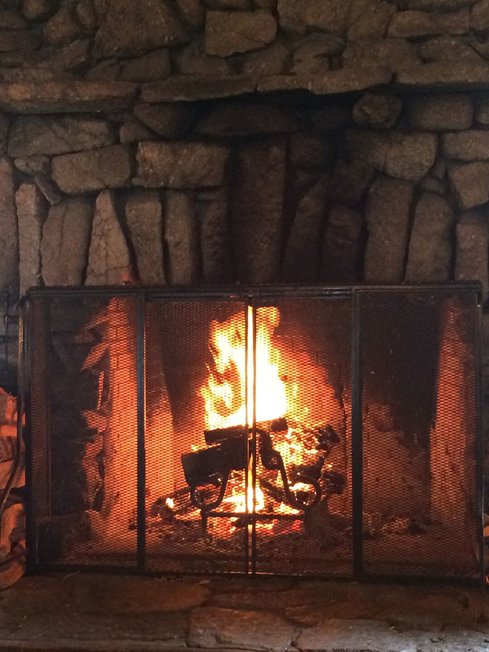 A fireplace by Julia Morgan at Asilomar.