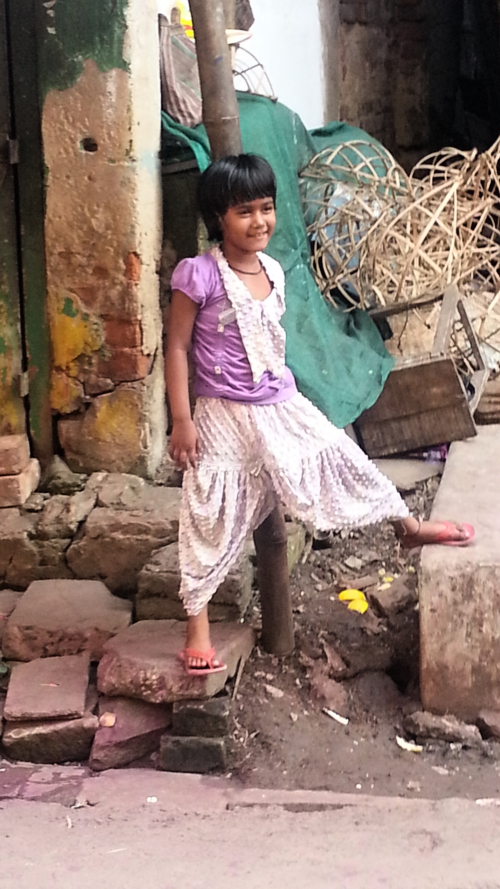 Girl playing in right outside of Sonagachi.