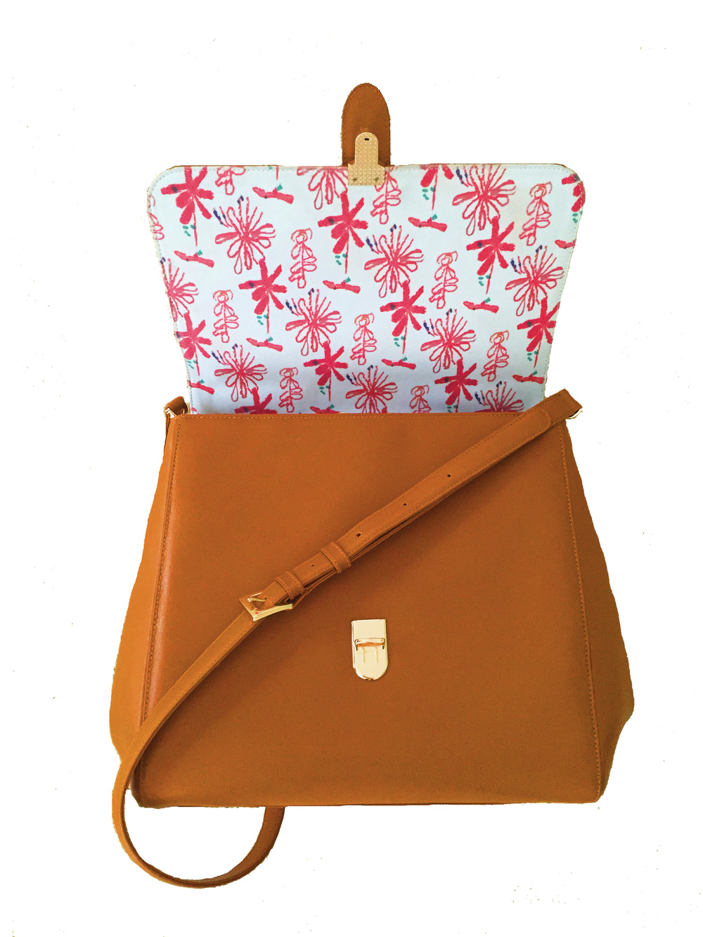 Noel's print featured in the Codet Satchel - Tan. Available for pre-order August 5th.