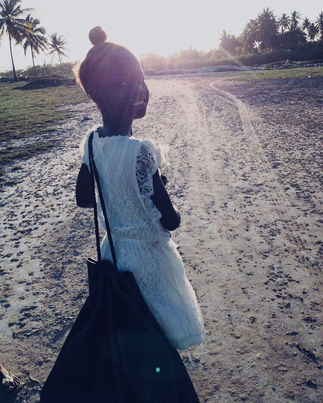 We carry justice so that she can be free. #InternationalDayOfTheGirl • • • • 📷: Laurie; La Croix, Haiti